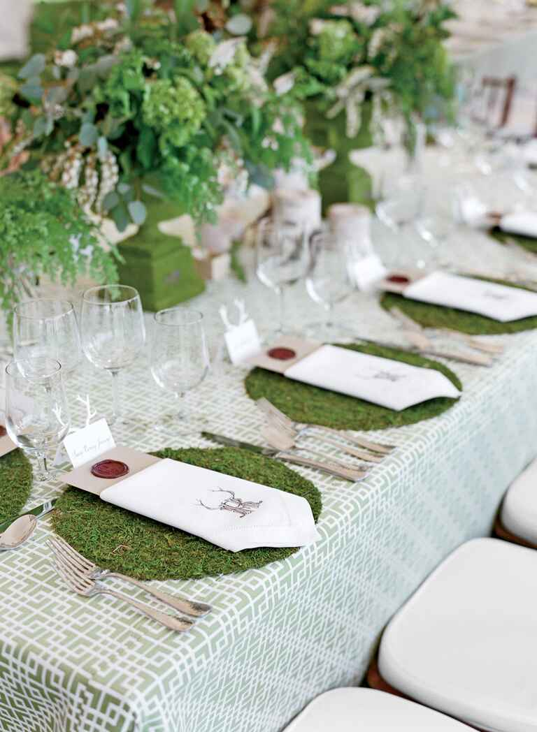 Wedding reception tablescape with green moss decor