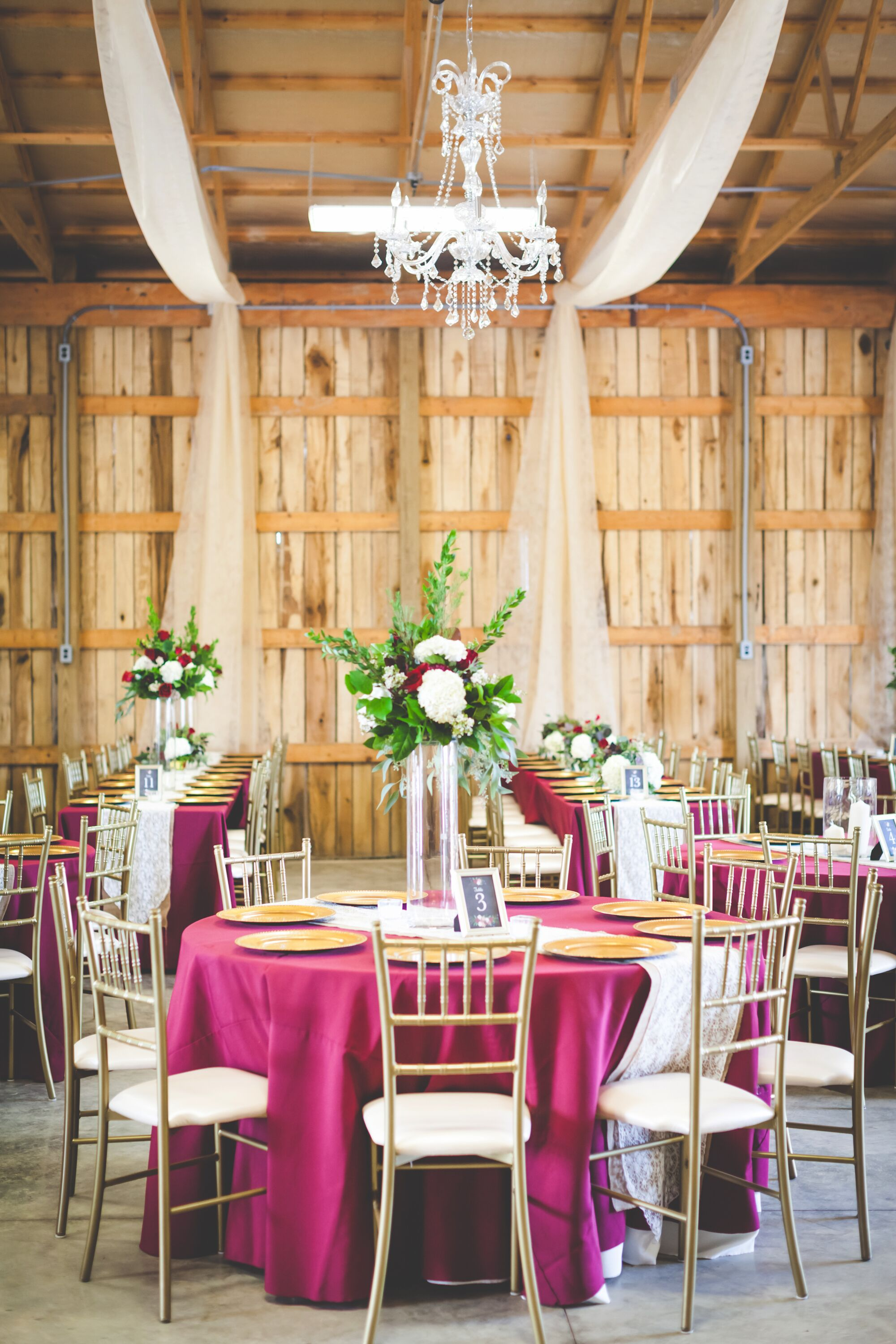 Tall burgundy and white floral centerpieces