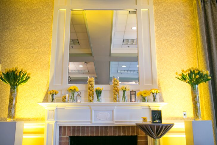 The mantle where Tiffany and Zack were married was decorated with a variety of yellow bouquets and vases filled with lemons.