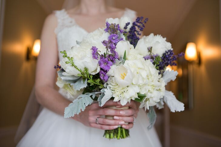 The gorgeous white and purple bridal bouquet contained a variety of blooms—from peonies to hydrangeas and lavender. The arrangement had accents of dusty miller thrown into the mix, and the bouquet truly embodied the day's beautiful palette.