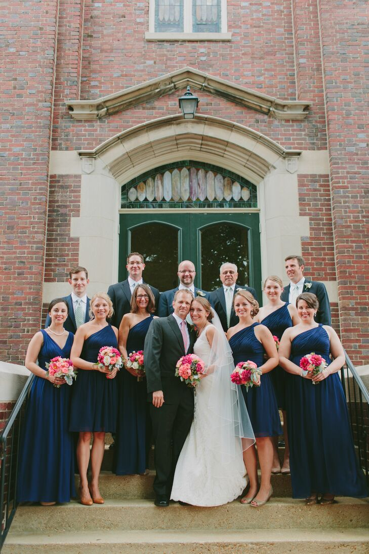 "Bridesmaids wore navy Donna Morgan dresses. Groomsmen wore their own suits. ""We wanted the feel to be classy and comfortable,"" Brittany says. ""It was important that everything went well together, but not that it be uniform."""