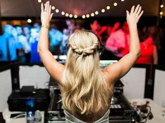 Bride as DJ at wedding reception