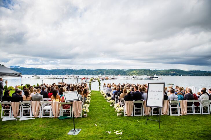 The ceremony took place on the front lawn of Alderbrook Resort and Spa in Union, Washington, with a beautiful backdrop of Hood Canal and Mount Ellinor in the distance. Arrangements perched on top of birch logs lined the aisle, leading up to the arch draped in hydrangeas, garden roses and greenery.