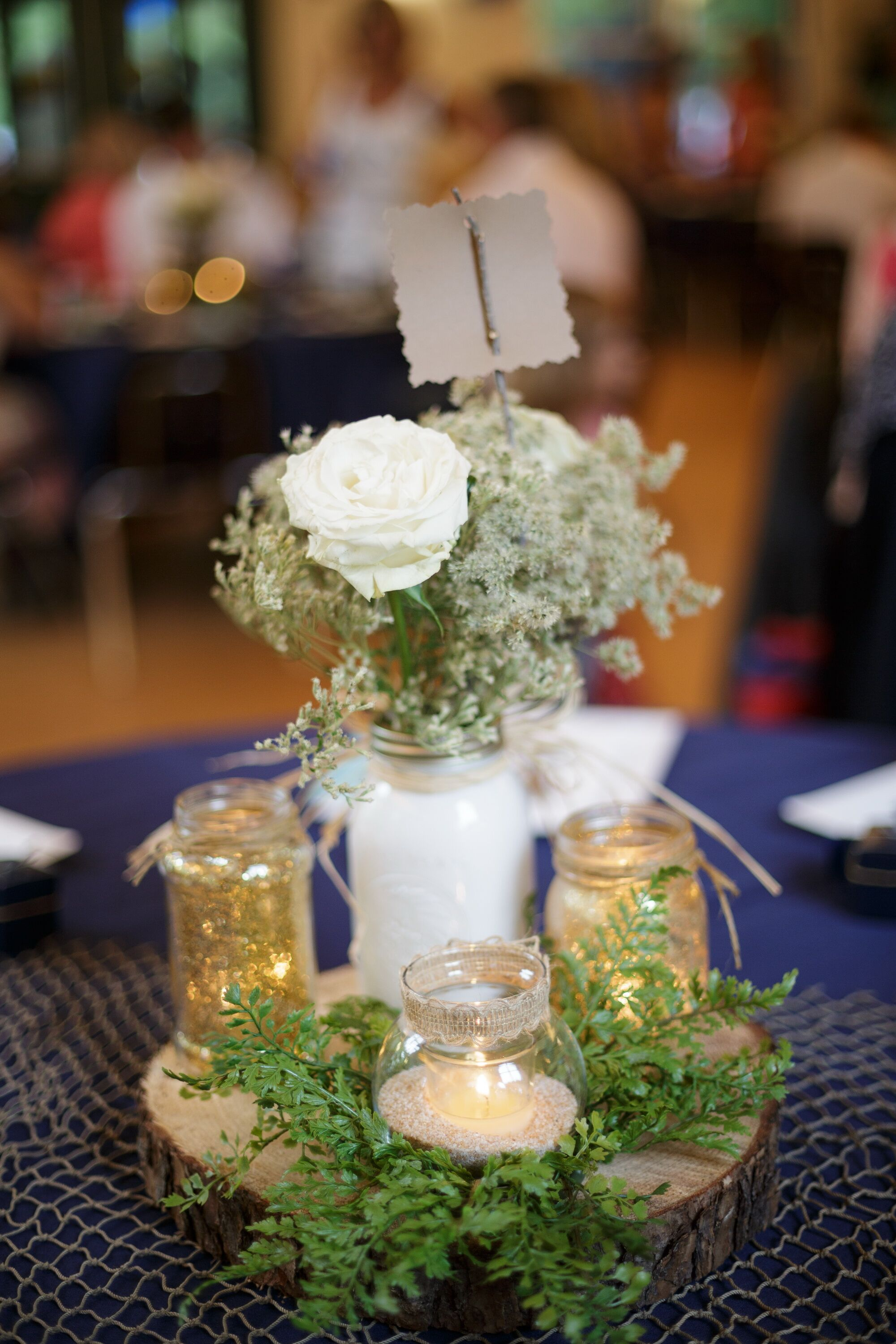 White rose and baby s breath mason jar centerpiece