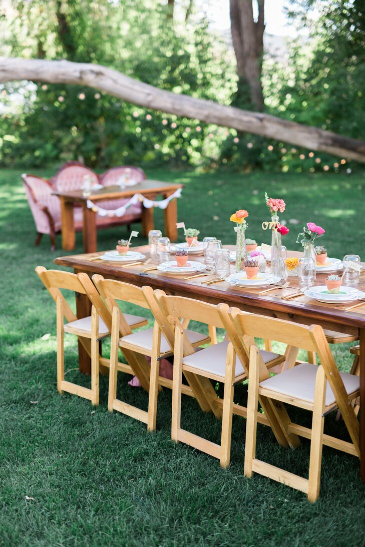 """We set up long rows of harvest tables that were crafted locally. Flowers were placed in clear vases and glassware that I collected from various thrift stores,"" Devin says."