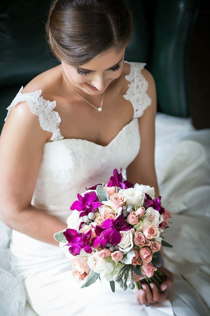 Jaymie carried a bouquet with royal purple orchids, blush and ivory roses, silver brunia and dusty miller.