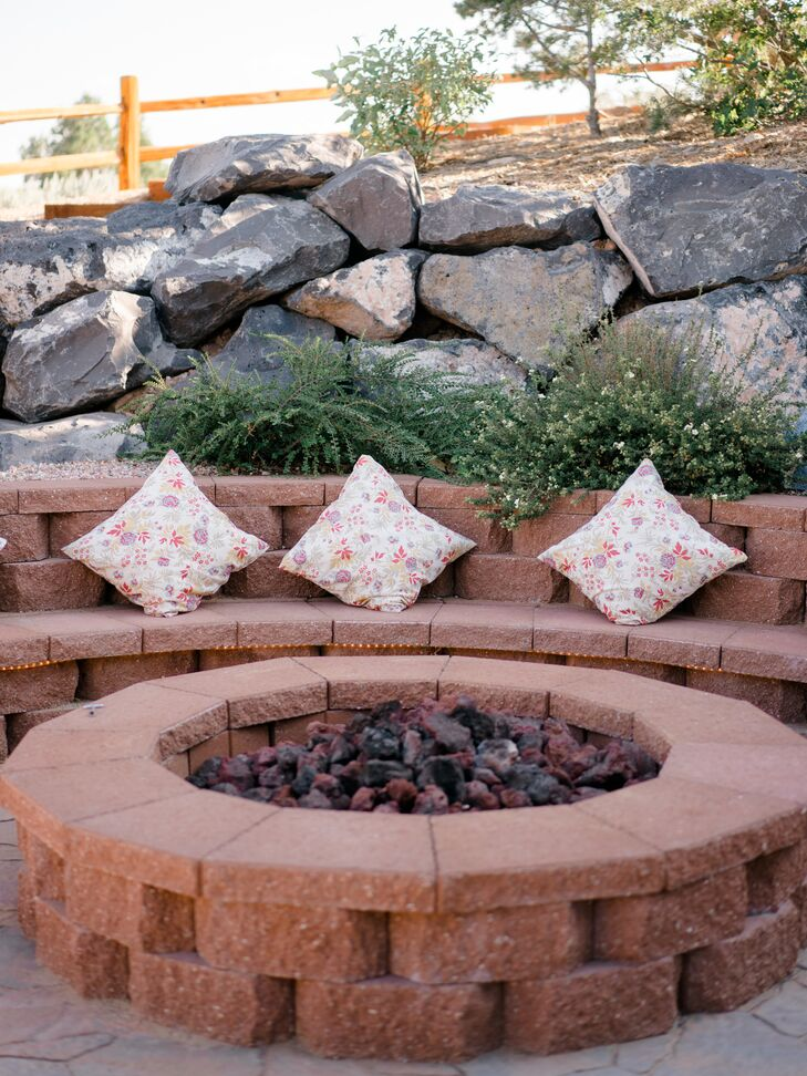 Stone Fire Pit with Printed Floral Pillows