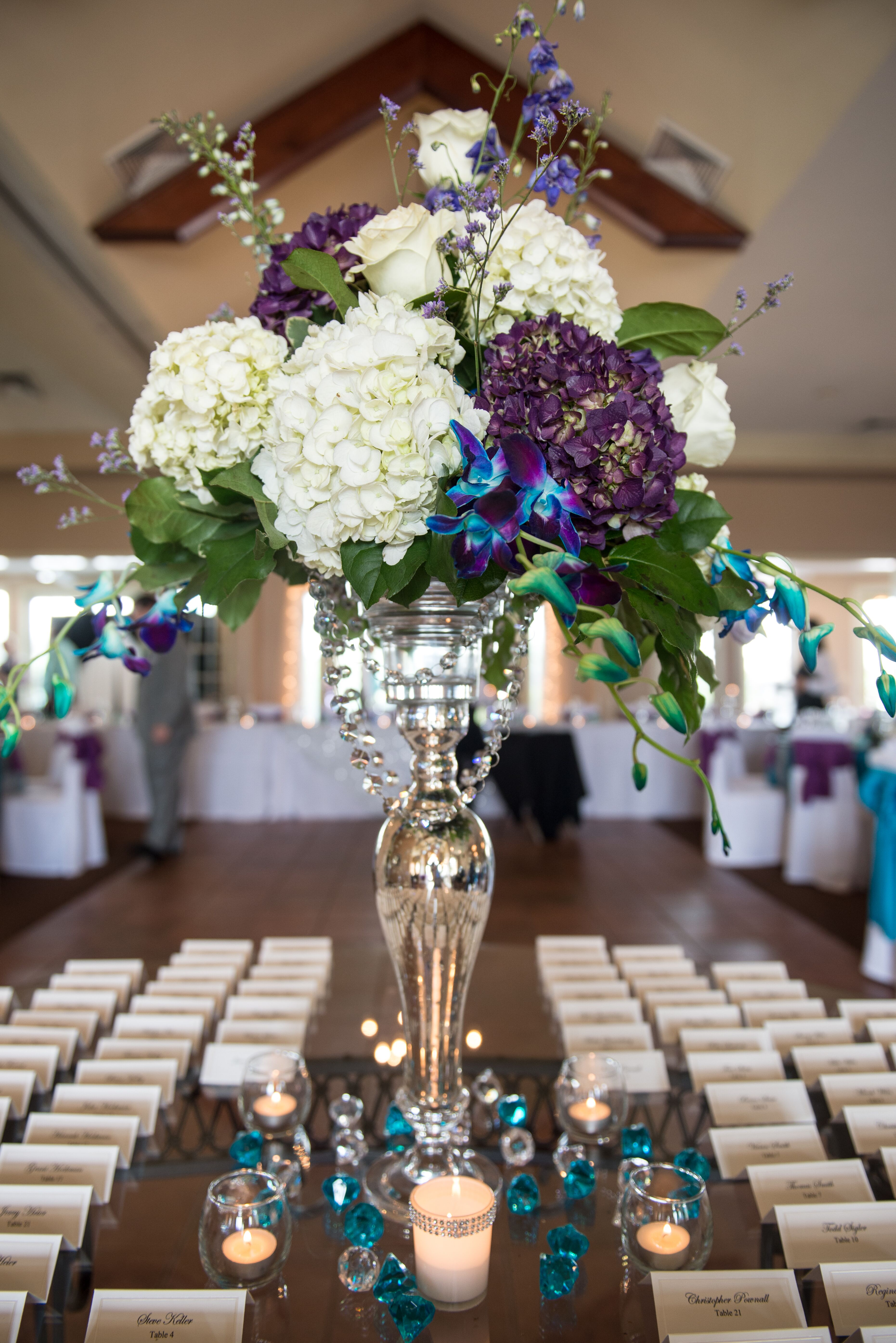 silver vase centerpieces with hydrangeas and orchids