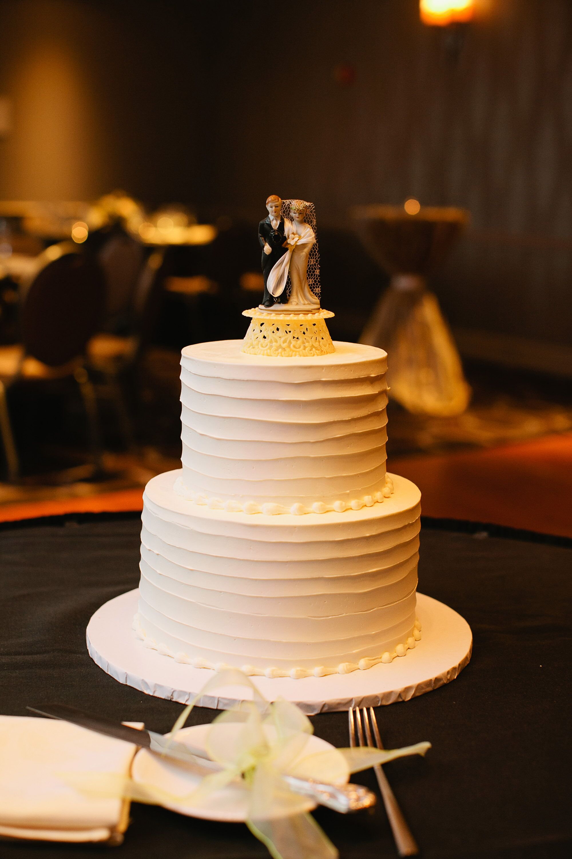 Two Tier Wedding Cake With Buttercream and Cake Topper