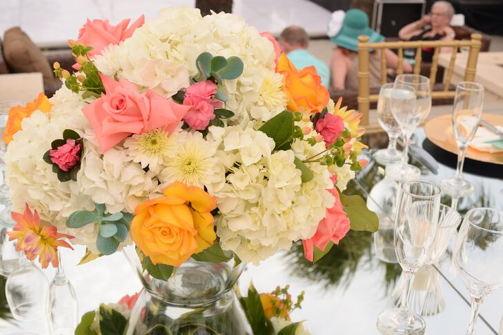 Tall overflowing coral and white centerpieces