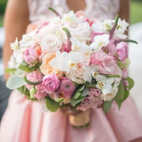 Playful Pink Orchid And Ranunculus Bouquet