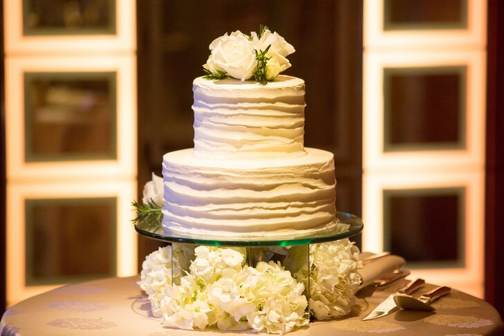 Two-Tiered Ruffled Wedding Cake Topped with Roses