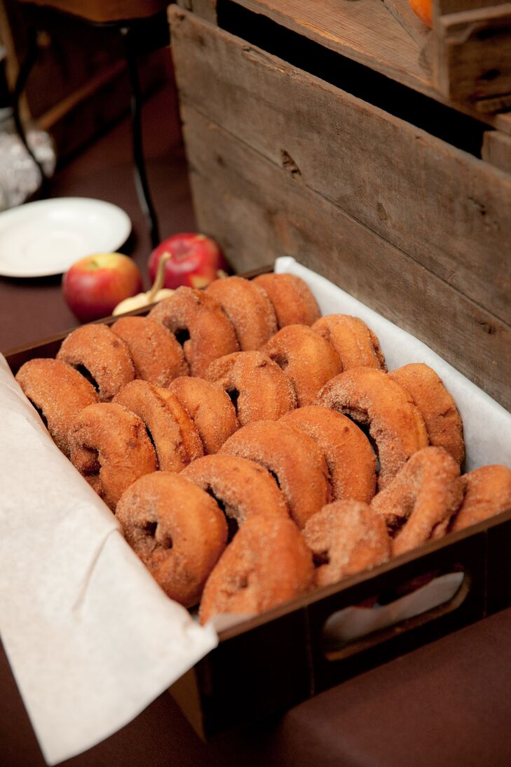 A subtle apple motif—which extended to the apple cinnamon donuts served during dessert—was inspired by Sara and Rob's fall wedding date and Sara's love for all things apple.
