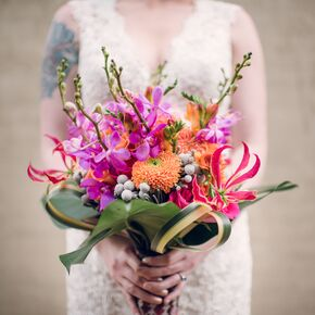 pink and orange bouquet with orchids and lilies