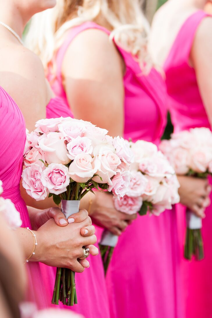 Kelley and Jeff wanted to create bright arrangements that stood out against their mountaintop setting, so they worked with Lee Vazquez Floral Design to make just that. Each bridesmaid carried this sweet arrangement of light pink roses and pink lisianthus that matched their fuchsia dresses.