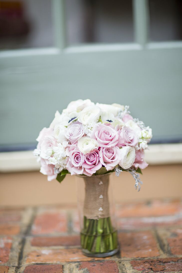 The bride carried roses, ranunculus, dusty miller and anemones in white and light pink.