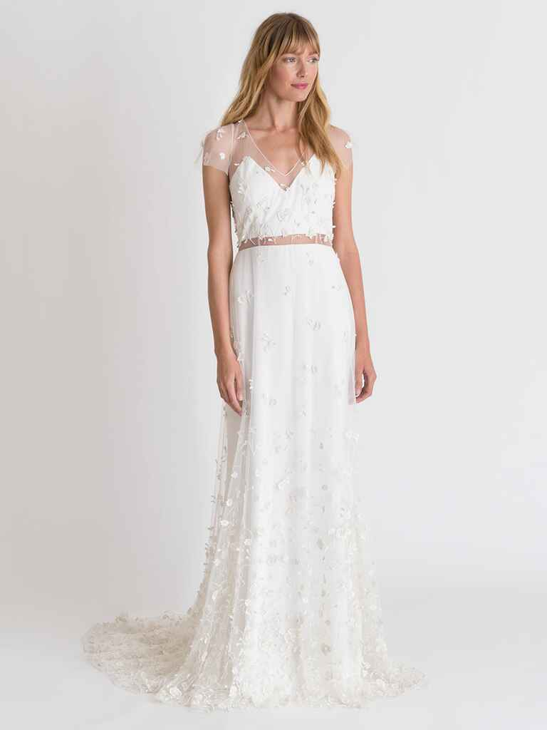 Alexandra Grecco Spring/Summer 2018 A-line wedding dress with floral appliqué and illusion sweetheart neckline, short sleeves and waist paneling