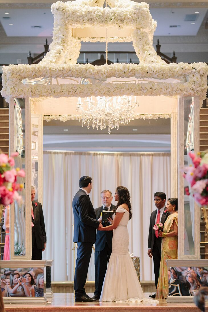 "At their Jewish ceremony, a rabbi tied Naina and Scott's cultures together and showed that, although they come from different religions, they share many similarities. Some of the Jewish traditions included signing a ketubah, circling each other seven times and breaking a glass under the chuppah— followed by a rousing ""mazel tov!"""