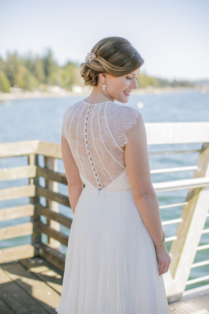 The back of Lindsey's wedding dress definitely made a statement, which had an illusion lace material accenting the back with buttons going down the middle.