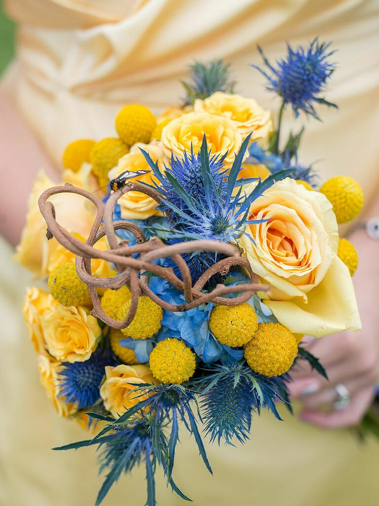 Yellow and blue bridesmaid bouquet with roses, thistle and billy balls