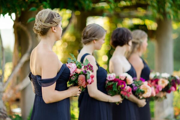 Blue wedding bouquets bridesmaids in navy dresses holding bright bouquets mightylinksfo