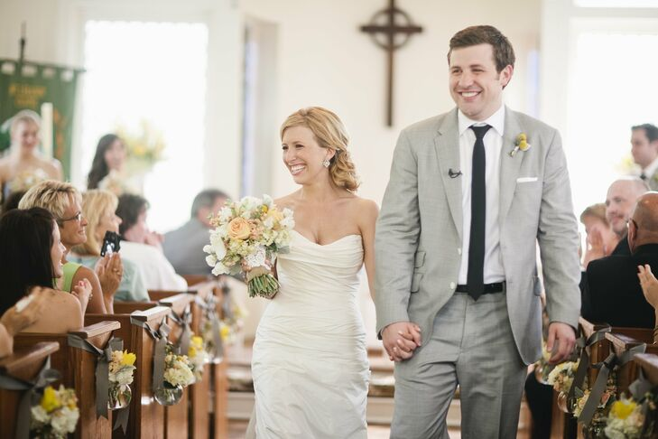 The ruched, modified sweetheart neckline on the bride's gown was perfectly feminine for the self-proclaimed girly-girl. Kevin chose a black skinny tie to go with his light-gray suit.