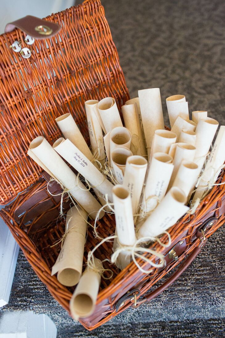 paper wedding program scrolls in basket