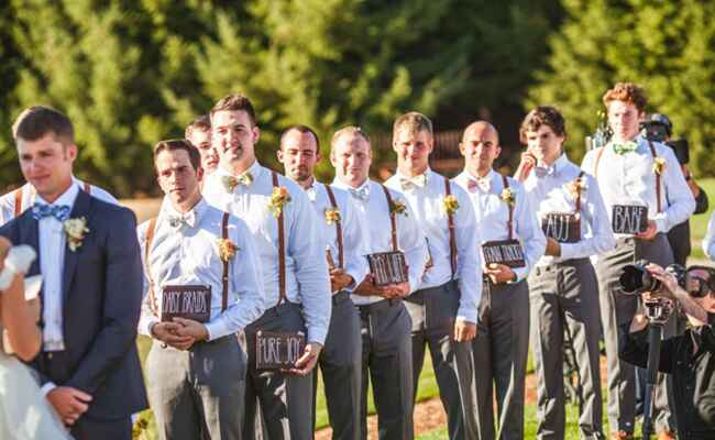 Audrey Roloff's groomsmen with signs