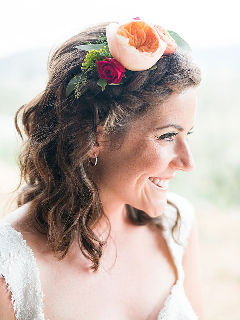 Short wedding hairstyle with a large braid and flowers