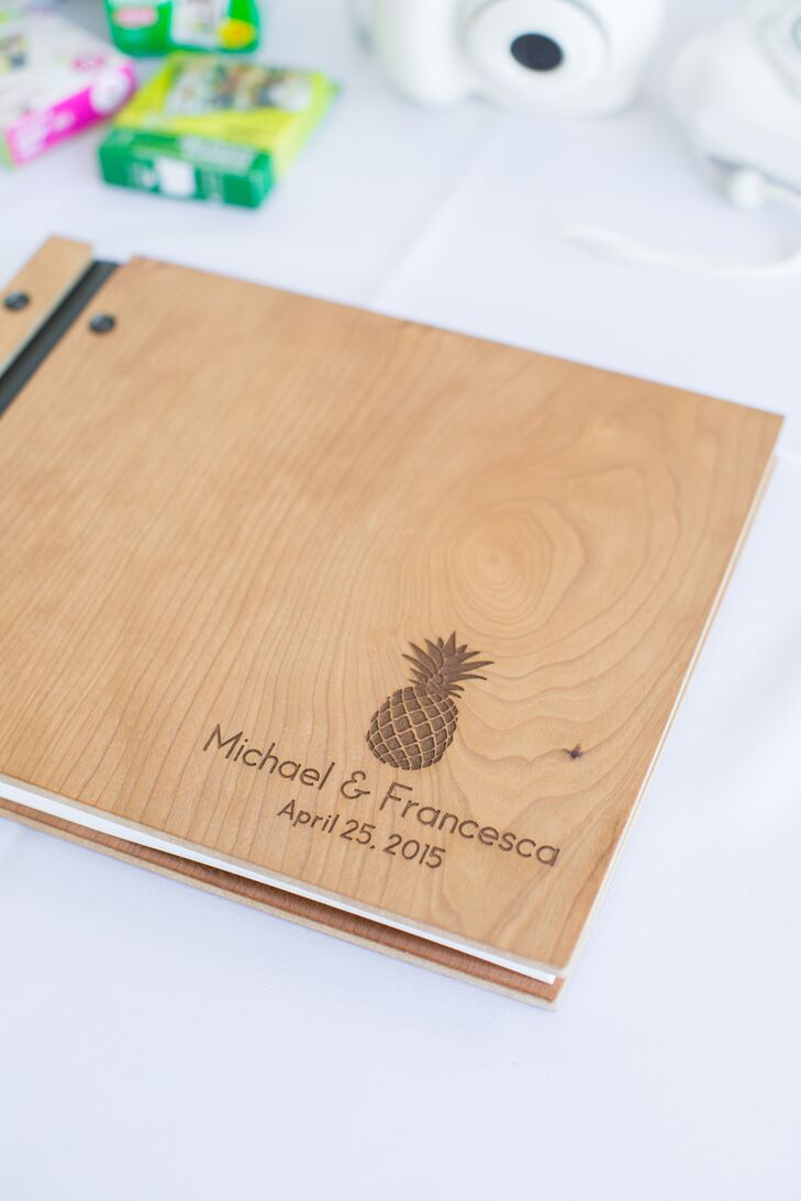 Even the guest book had a pineapple. Francesca's favorite fruit decorated the front of their custom wood-inspired guest book, ensuring this motif would be a part of the day's memories.