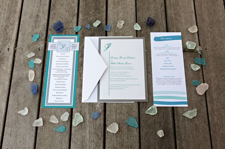 When designing their wedding invitations, Lindsey and Keith wanted to transport their guests to sea. They chose a brilliant palette of teal, sea green and blue to give guests a taste of the seaside affair to come, then carried the motif throughout the rest of the stationery, from the programs to menus and even the escort cards.