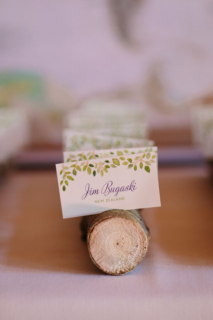 All the stationery was decorated with green watercolor leaves. The escort cards were decorated with foliage across the top and were displayed in little wooden logs to match the rustic mountain location.