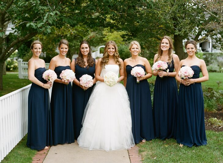 "Caity's six bridesmaids wore long chiffon Monique Lhullier dresses. ""I picked the color, length and fabric and then let the girls pick out their individual styles,"" says Caity. Everyone has different body types and doing this allowed all of them to look great."" As bridesmaid gifts, she gave each girl a navy ""Island Tie"" bracelet from C.B. Stark in Edgartown to wear on the wedding day."