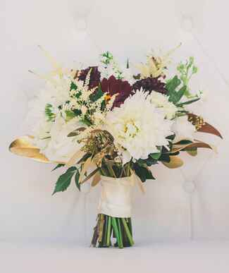 White and burgundy bridal bouquet with gold-painted leaves