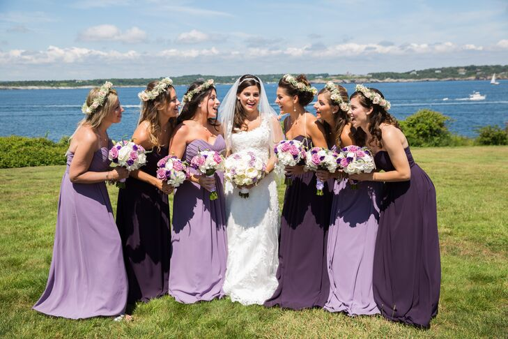 Christina chose a romantic look for her bridesmaids, having the girls don matching floor-length gowns with sweetheart necklines in two shades of purple. The girls accessorized with a simple pendant necklace and whimsical flower crowns with baby's breath and blush roses.