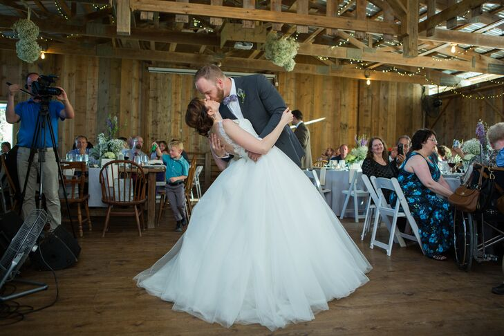 As  Elena and Greg danced on the wood floor during their first dance, Elena's tulle ball gown skirt swayed with every move.