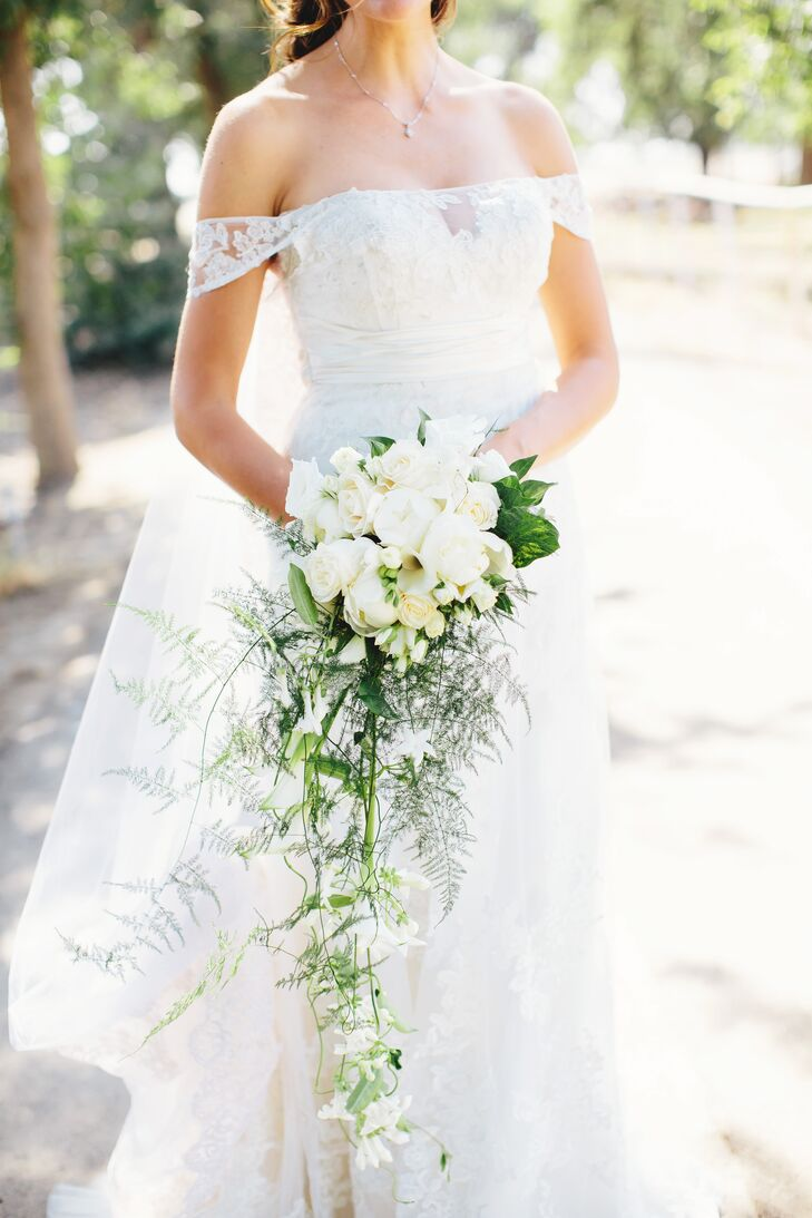 """My wedding dress was the first one I tried on. My niece of five years asked me to try on this ""princess"" dress and I ended up loving it,"" says Anna. ""We added little lace drop sleeves for added elegance. It was classy, but still felt woodsy and sexy."" rn"