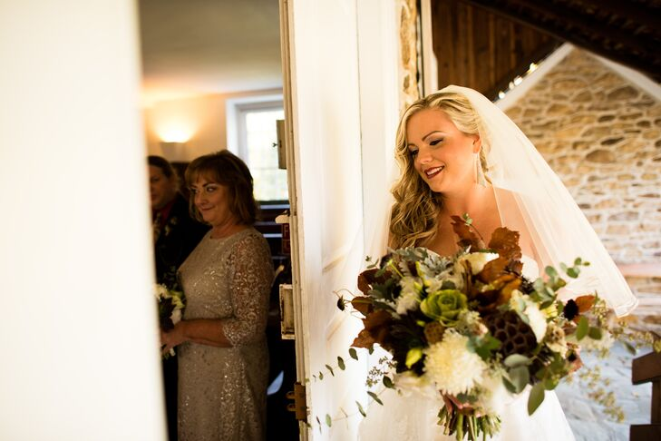 Jenna's bouquet consisted of seed pods, white football chrysanthemums and other dried flowers.