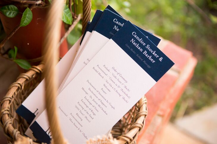With pumpkins, tulle, hay bales and burlap surrounding their wedding, Candice and Nathan took a step back with the stationery design. They went with a classic navy and white program and had their names sectioned-off along the top.