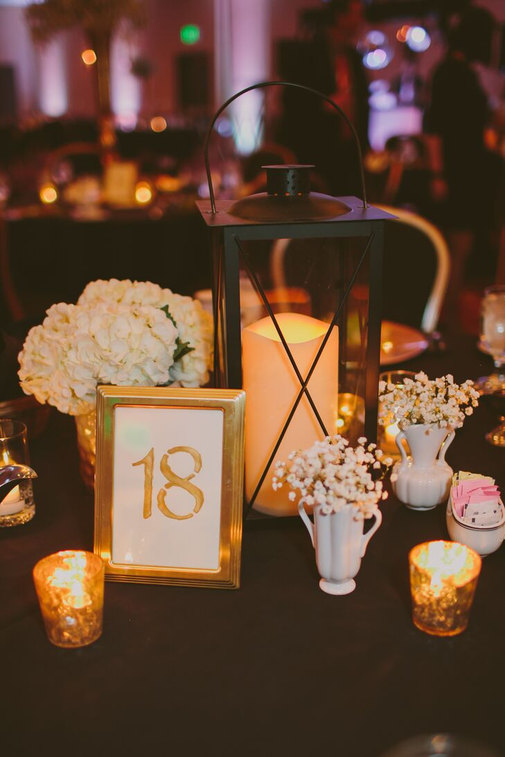Gold Framed Table Numbers with Lanterns and White Hydrangeas at ...