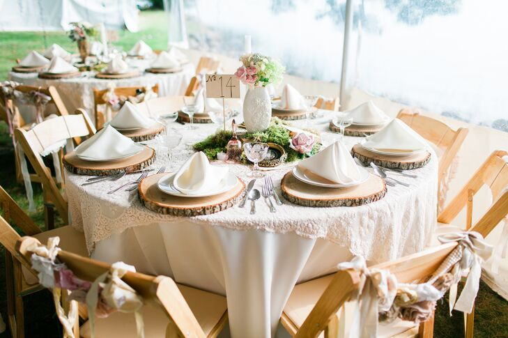 Round reception tables were topped with ivory linens, a vintage lace overlay and sliced-wood chargers. Eclectic centerpieces ranged from rolled-up sheet music to vintage books and antique candelabras paired with natural moss.