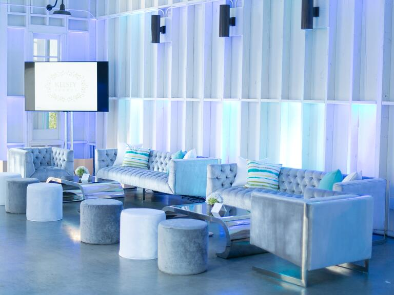 Modern lounge furniture and blue uplighting