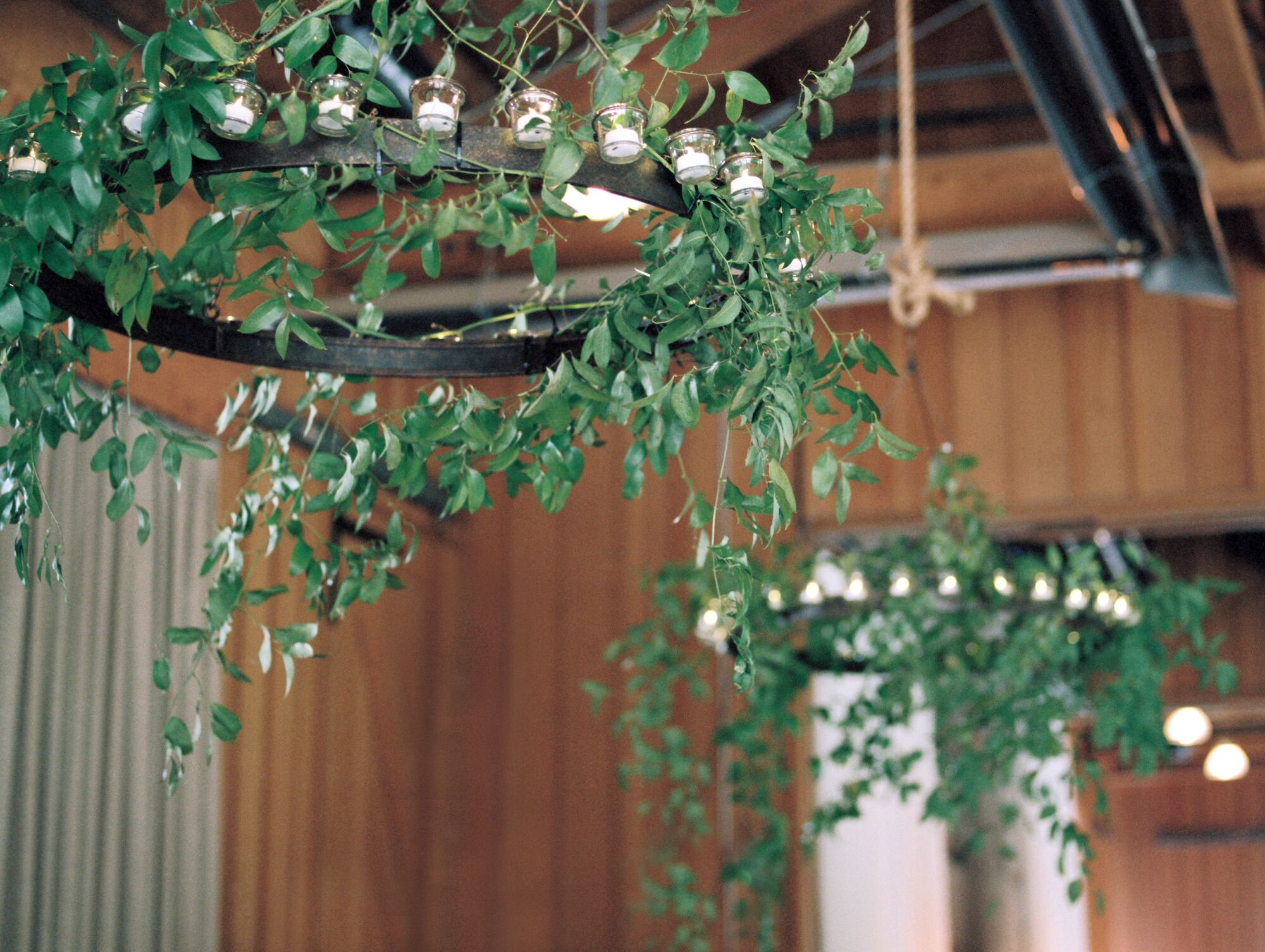 Iron Chandeliers With Greenery
