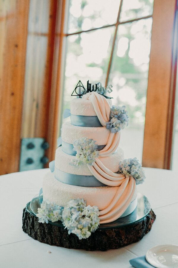 Blue wedding cakes wedding cake with blue ribbon fondant draping and harry potter topper junglespirit Image collections