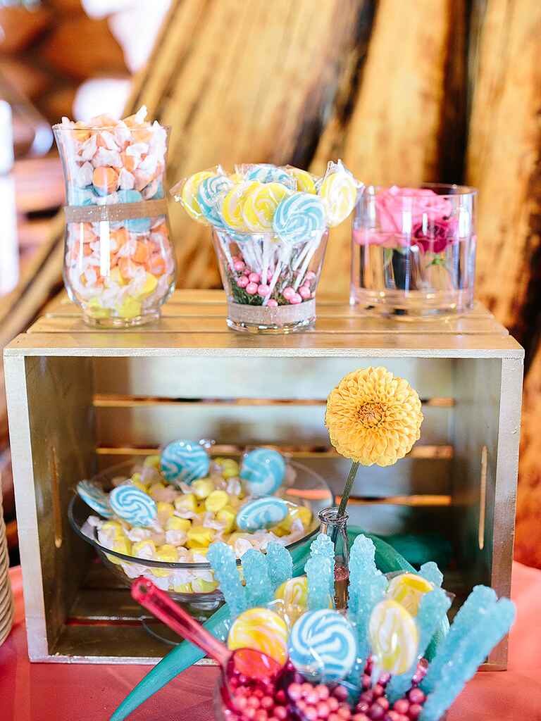 Blue and yellow wedding reception candy bar