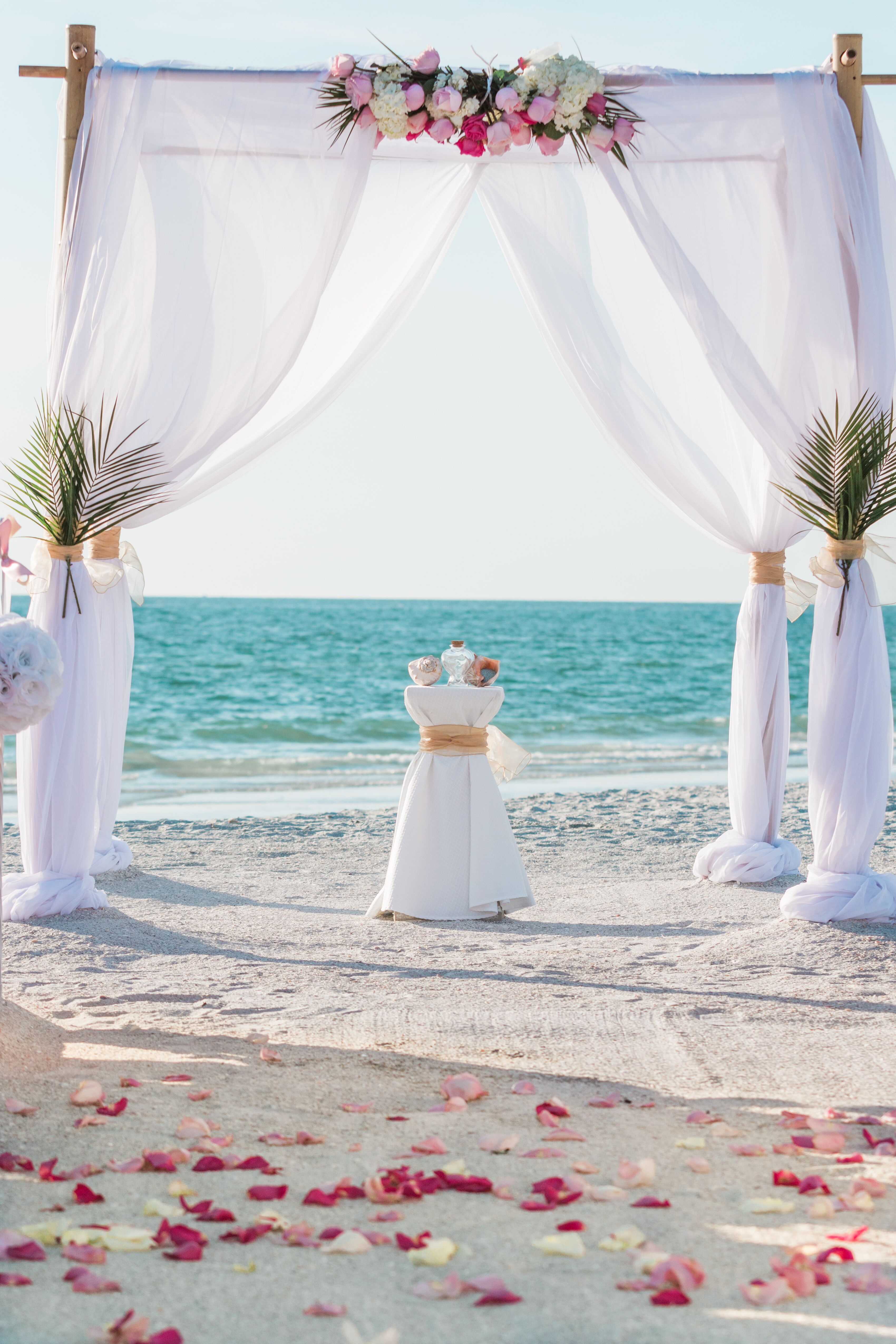 White Wedding Arbor With Palm Fronds