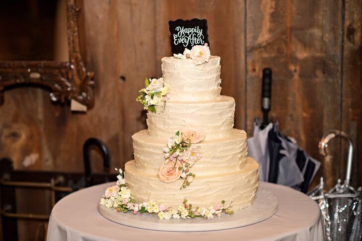 A Four Tier Rustic Buttercream Wedding Cake With A