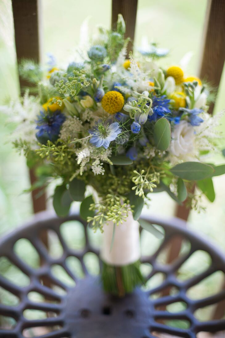 Karen held a lush bouquet of wildflowers, craspedia, and eucalyptus in hues of yellow, blue and ivory.