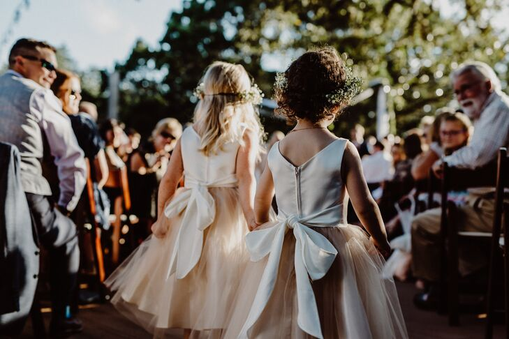 Emily's flower girls donned peach tulle dresses with ivory bodices.