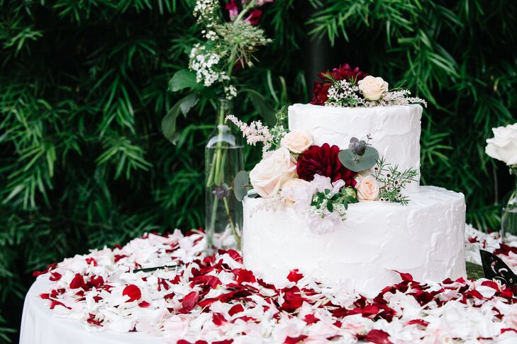 Two Tier White Wedding Cake With Flowers And Greenery